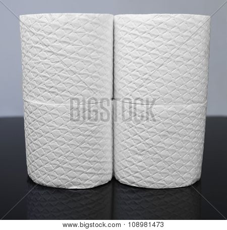 Many White Embossed Rolls Of Toilet Paper