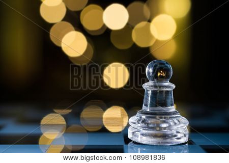 Transparent Pawn On Blue Chessboard With Bokeh