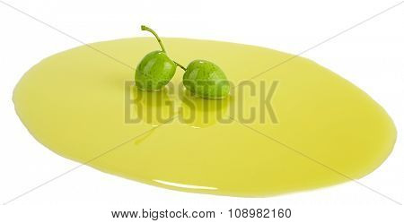 Oil on green olive isolated on white background.