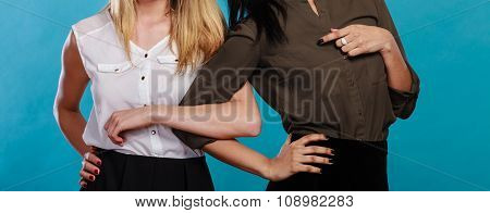 Two Women Caucasian And African Holding Hands.
