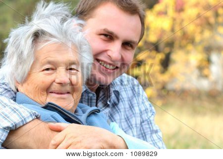 Elderly Lady And Young Man