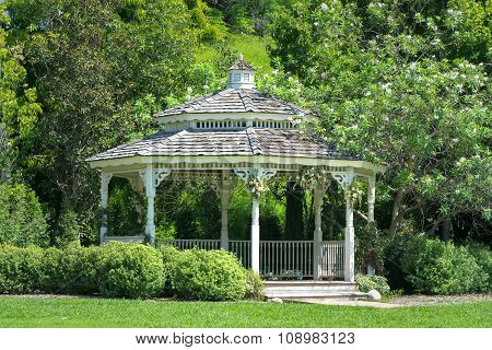 White Ornate Gazebo In The Forest
