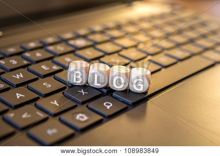 Blog Dices On A Laptop Keyboard