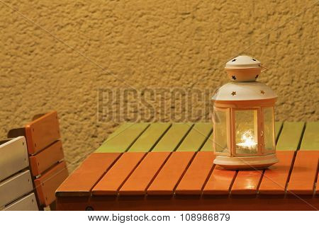Smalllighting Candle Lantern Standing On Colorful Table