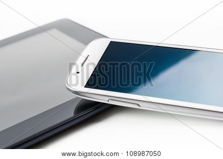 White Smartphone Leaning On A Tablet #2