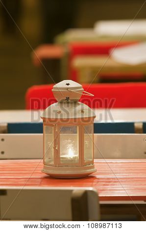 Smalllighting Candle Lantern Standing On Table