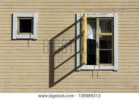 Open Window Casting Shadow