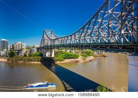 BRISBANE, AUS - SEP 09 2015: Ferry boat under Story Bridge in Brisbane, Queensland, Australia.