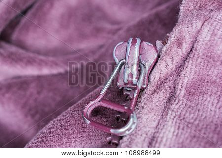 Macro Of The Front Of A Purple Used Zipper