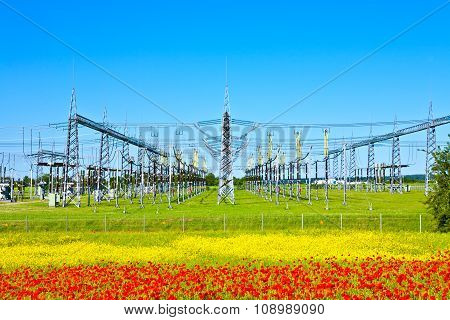 Electrical Power Plant In Beautiful Colorful Meadow