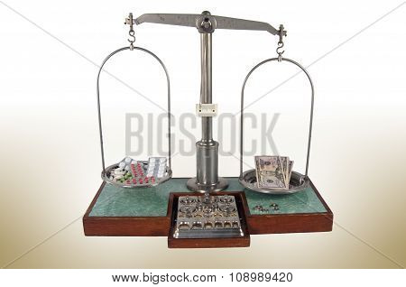 Old Style Pharmacy Scale With Money Heavier Than Drugs