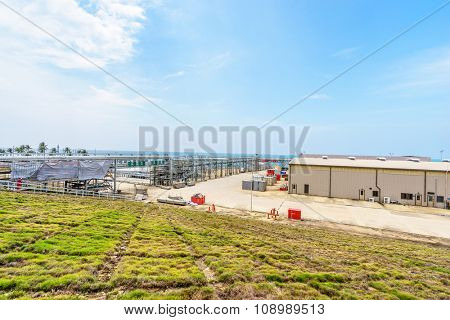 house of oil refinery plant in blue sky