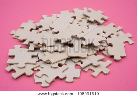 Jigsaw Puzzle On A Pink Background