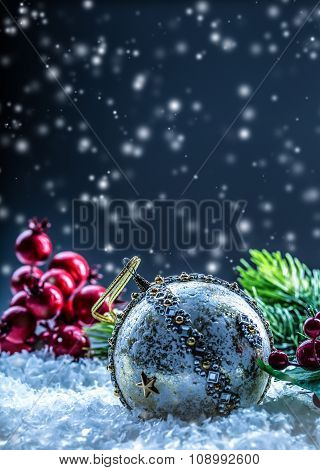 Christmas card with ball fir and decor on glitter background. Christmas ball on glitter background.