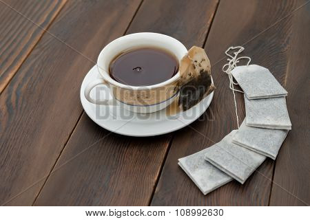 Cup Of Tea And New Teabags On A Wooden Background