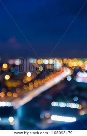 Abstract blurred bokeh, city road curved background at night