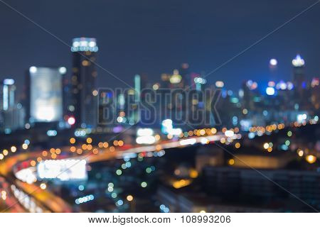 Abstract blurred bokeh lights city downtown and road at nights