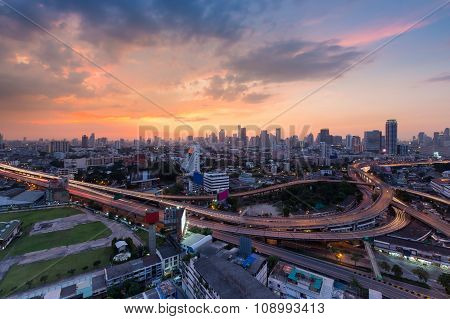 Beautiful sunset of Bangkok city downtown with main highway interchange