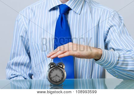 Hands of businessman holding with care time concept