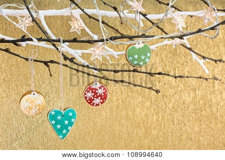 Christmas Homemade Gingerbread Cookies Hanging On A Tree Branch