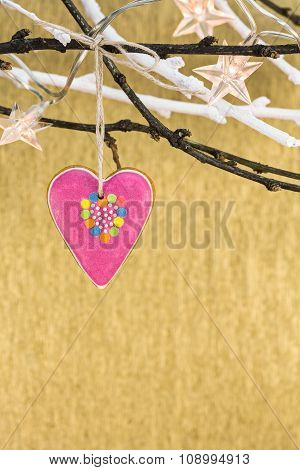 Christmas Lights With Gingerbread Heart Hanging On A Branch