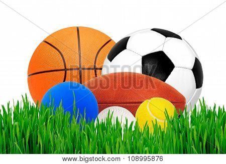 Sport Balls In Green Grass Isolated On White