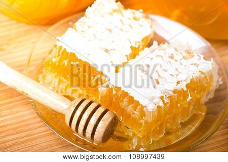 Honey. Closeup of honeycombs wax and honey dipper