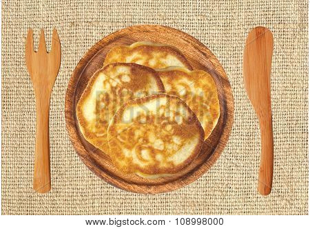 Fritters In Wooden Plate, Closeup, On Burlap Background