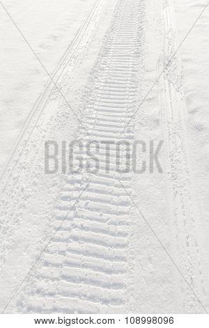 Trail Of Wheel In Fresh Snow