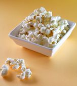 picture of matinee  - popcorn in white bowl on orange background - JPG