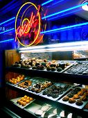 Donut Shop Display With Neon Fresh Sign