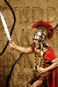 foto of legion  - Roman legionary soldier in front of abstract wall - JPG