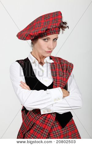 unsatisfied woman crossing arms and wearing Scottish clothes
