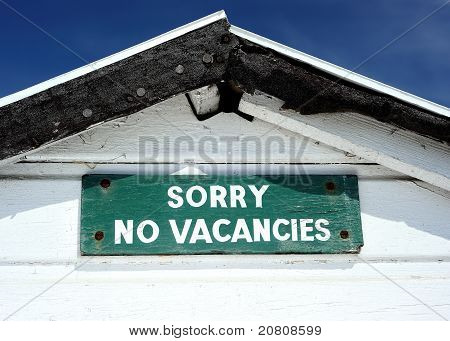Old beach hut with funny sign sorry no vacancies