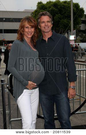 LOS ANGELES - JUN 8:  Wendy Braun, Josh Coxx arriving at the