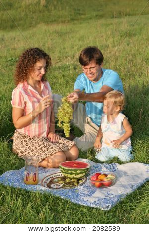 Parents With Daughter On Picnic