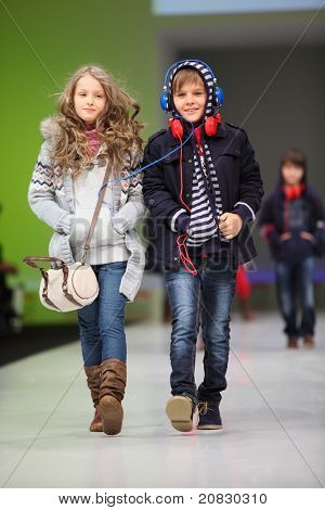 MOSCOW - FEBRUARY 22: Unidentified child models wear fashions from Snowimage and walk the catwalk in the Collection Premiere Moscow,  an international fashion fair for Eastern Europe, on February 22, 2011 in Moscow, Russia.