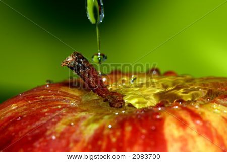 water drop over red apple