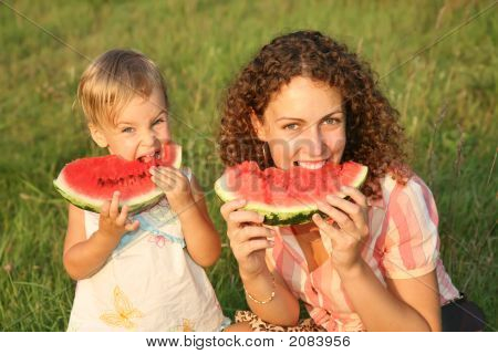 Mother And Daughter Eat Watermelon