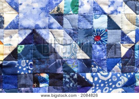Patchwork Squares On Blue Quilt