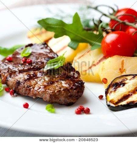 Gourmet grilled steak flavoured with pink pepper and basil