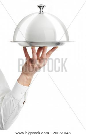 Close up hand of waiter with metal cloche lid cover and tray