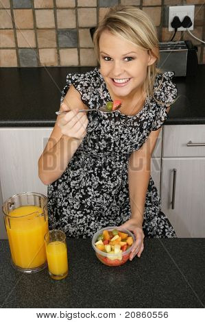 Pretty Blond Woman Eating Breakfast