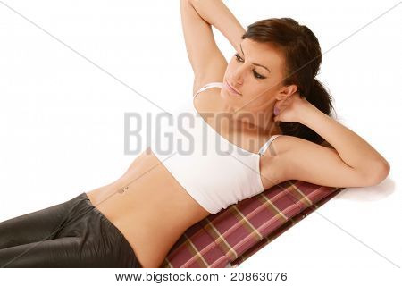 Closeup of a young woman doing exercises, isolated on white