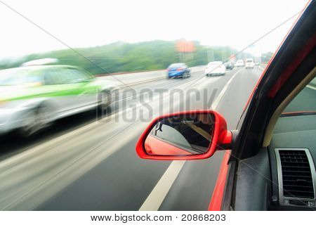 shoot from the window of rush car,motion blur steet
