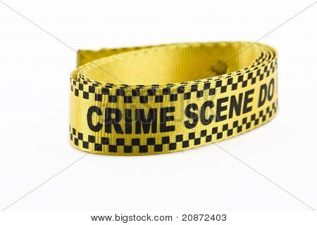 Crime scene banner rolled up isolated on white