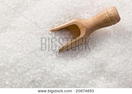 salt crystals in wooden scoop