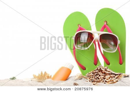 summer holidays memories from beach with shells and sunglasses on sand