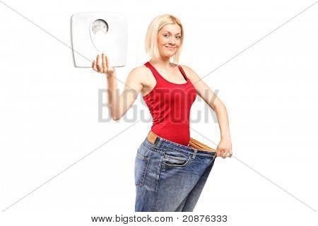 Portrait of a weight loss female holding a weight scale isolated on white background