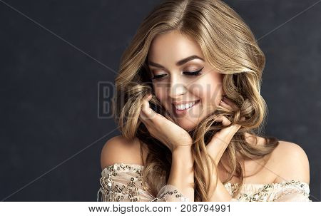 poster of Brunette  girl with long  and   shiny curly hair .  Beautiful  model woman  with curly hairstyle. Care and beauty hair products